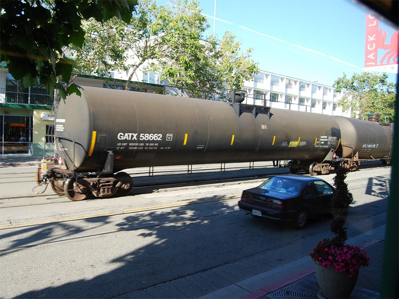 Rail traffic travels through the City of Oakland, near Jack London Square.