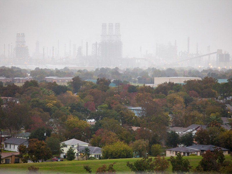 An oil refinery looms over the west side of Port Arthur, TX.