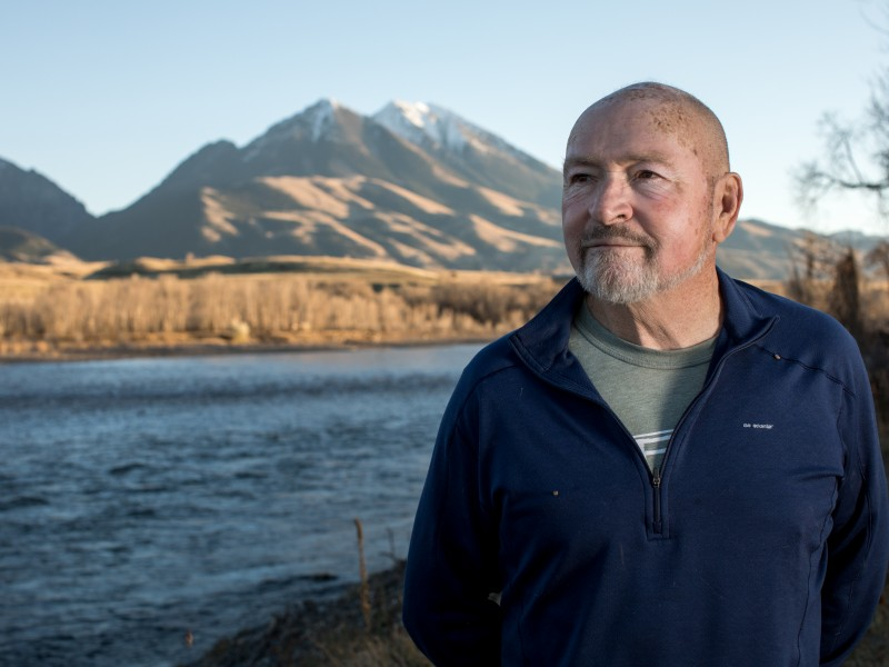 Doug Peacock stands on the edge of the Yellowstone River in Emigrant, Montana.