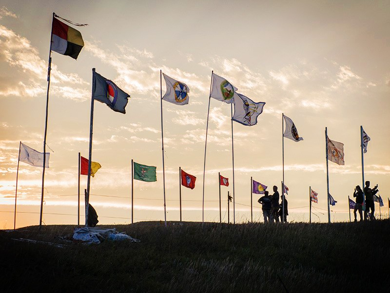 Flags fly at the Sacred Stone Camp, Cannonball, North Dakota.