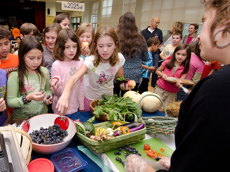A school lunch event in Arlington, VA, teaches children about nutrition.