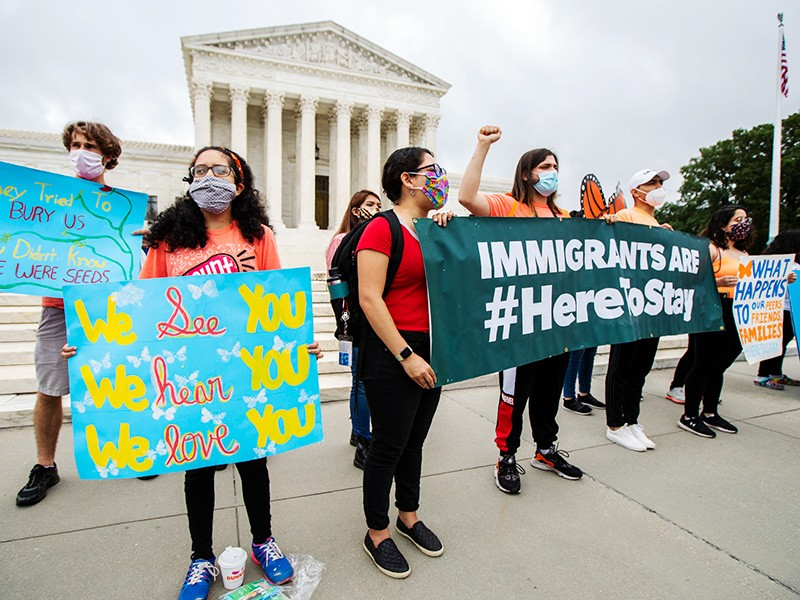 Deferred Action for Childhood Arrivals (DACA) students celebrate in front of the U.S. Supreme Court after the high court rejects the administration's bid to end legal protections for young immigrants, Jun. 18, 2020.