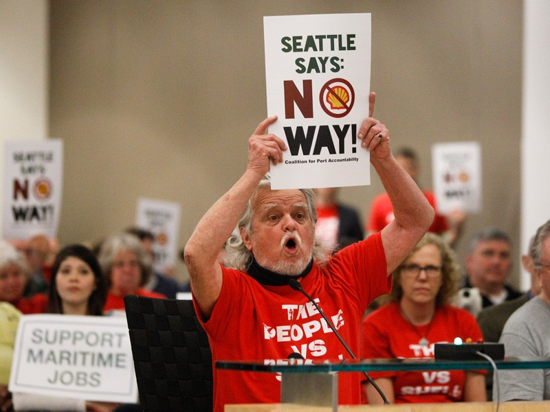 Jack Smith speaks to the Port of Seattle commissioners on March 24