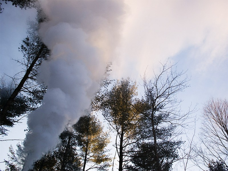 Smoke from a wood boiler. The devices emit high volumes of hazardous air pollutants and carcinogens.