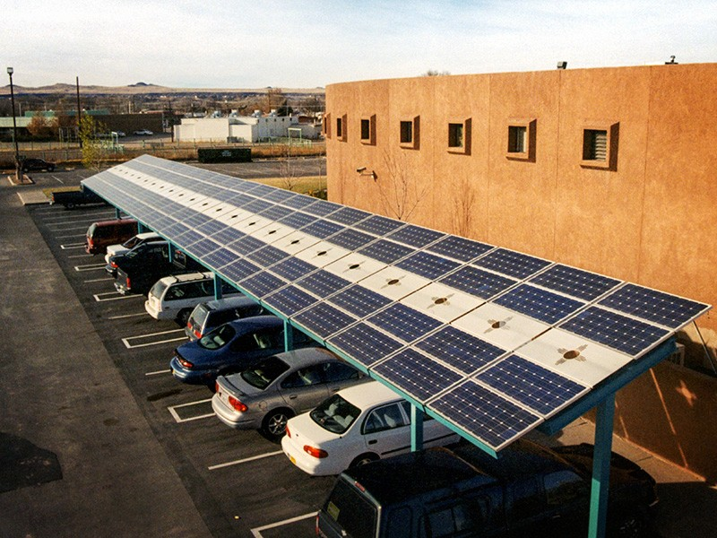 A solar carport at the Indian Pueblo Cultural Center in Albuquerque, New Mexico. The array delivers about 23 megawatt hours of clean electricity annually to the local utility grid.