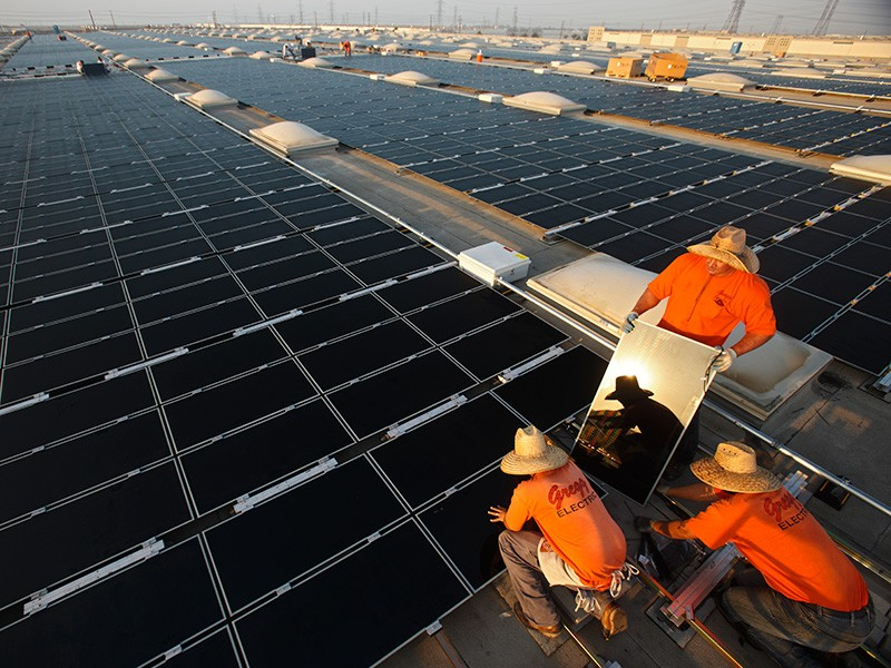 Southern California Edison solar technicians install photovoltaic panels on rooftops in Fontana, California.