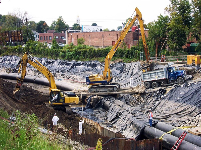 Contractors work on the GE Housatonic Superfund project in Massachusetts.