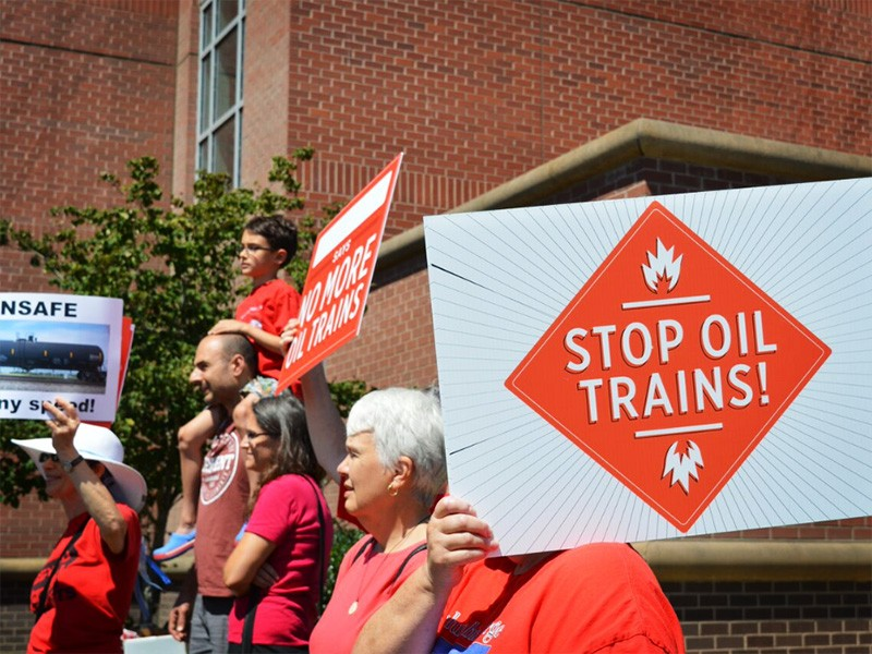 """More than 100 community members took part in the """"Stand Up to Oil Rally"""" on July 29."""