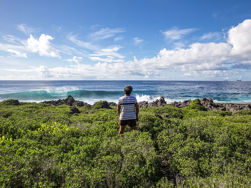 Deborah Fleming, a member of the Tinian Women Association, looks out onto the Pacific Ocean from the island of Tinian.