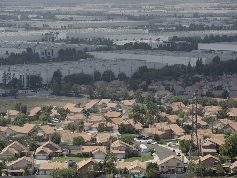 Warehouses bump up against homes in the Inland Empire.
