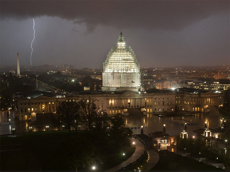 Lightning strikes behind the U.S. Capitol.