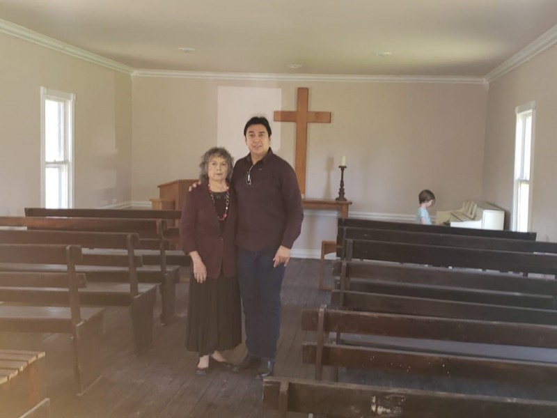 Descendants of Eli Jackson stand in the 154-year-old Texan church that bears his name. Construction on Trump's border wall may desecrate a cemetery next to the church.