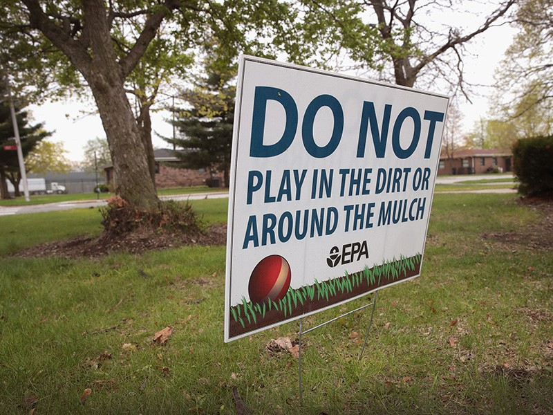 A sign, placed by the EPA, warns people not to play on the lawn at the West Calumet Housing Complex on April 19, 2017, in East Chicago, Indiana. Nearly all the residents of the complex were ordered to move by the East Chicago Housing Authority after the s