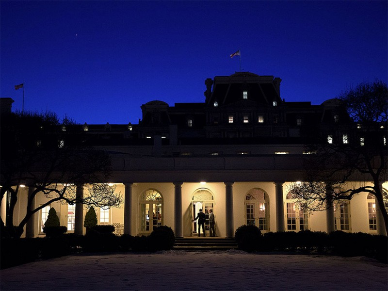 President Obama enters the Oval Office at dusk.