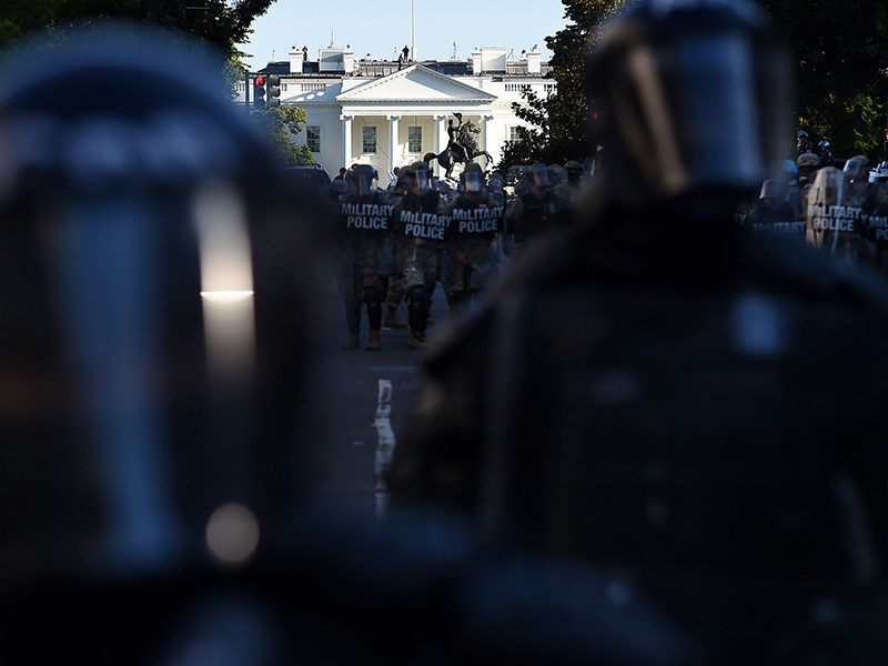 Military police hold a perimeter near the White House as people gather in Washington, D.C., on June 1, 2020, to protest the killing of George Floyd.