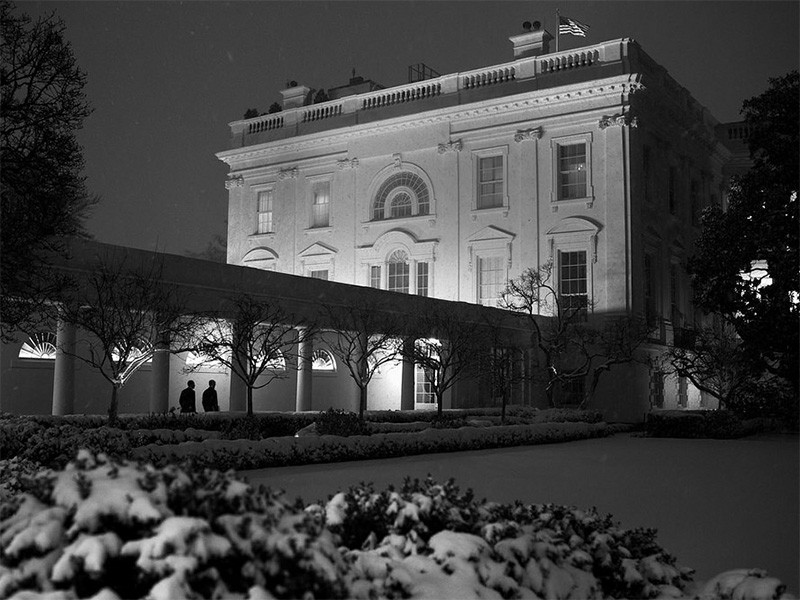 Snow blankets the Rose Garden at the White House.