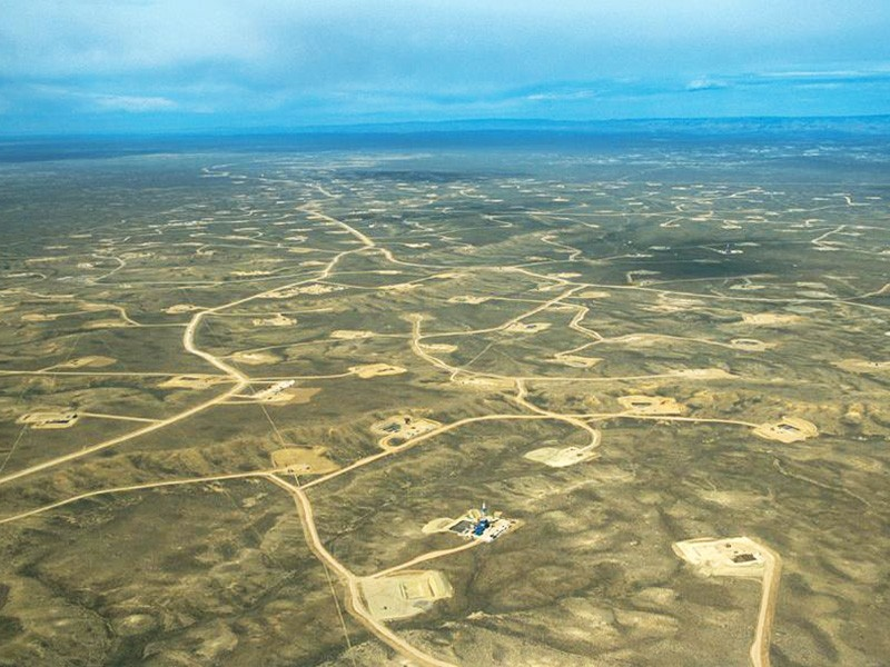 An aerial view of the Upper Green River Valley of Wyoming shows the vast network of roads and well pads that make up a portion of the Jonah natural gas field.