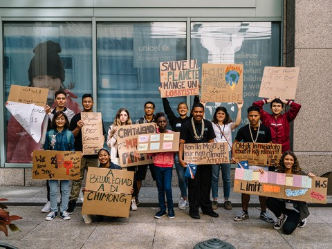 Youth petitioners display their signs before marching in the Sept. 20 Global Climate Strike in New York City.