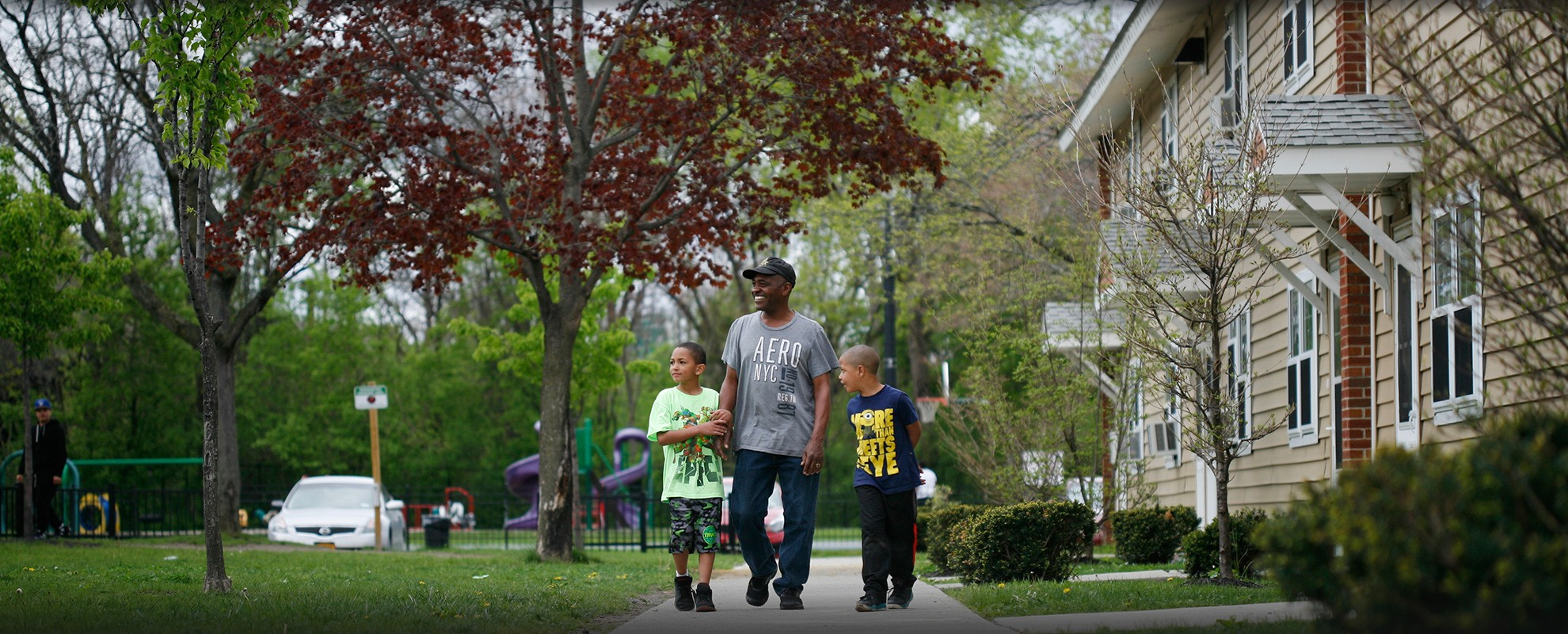 Be Be White, with his son Brayton (left) and Jahcere, walk through the Ezra Prentice complex.
