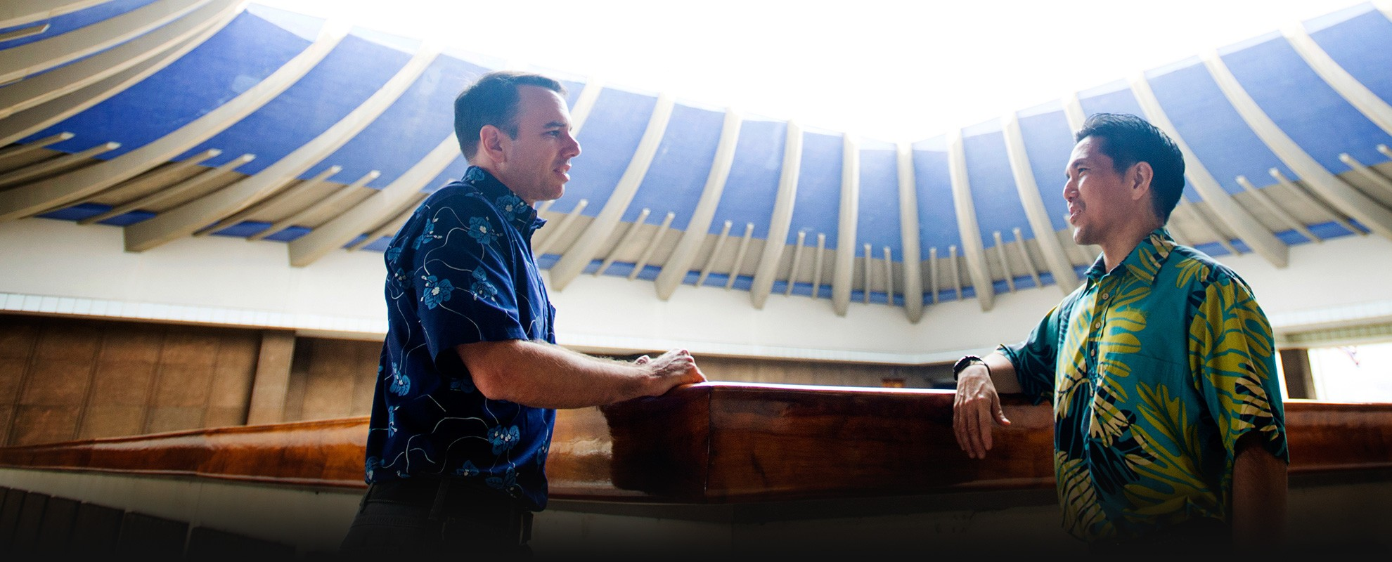 Isaac Moriwake (right), staff attorney in the Mid-Pacific Office, speaks with Mark Duda, a solar industry leader and longtime Earthjustice partner, in Hawaiʻi's State Capitol.