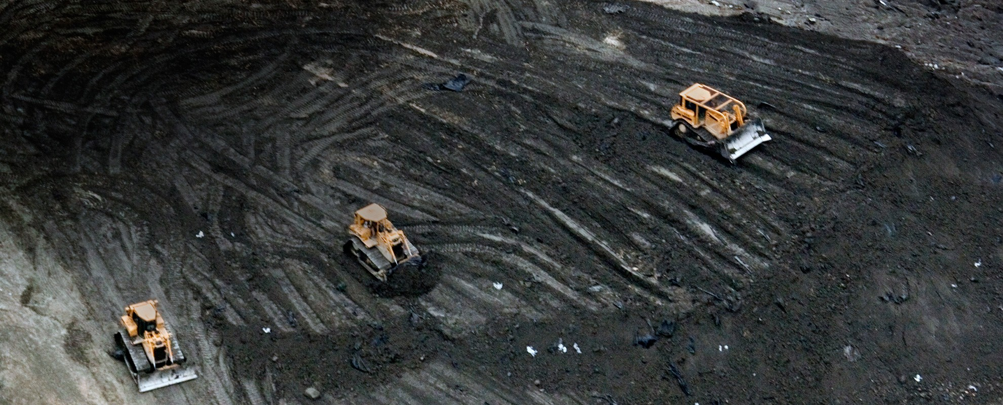 Bulldozers work on the enormous pile of toxic coal ash at Arrowhead Landfill in Alabama.