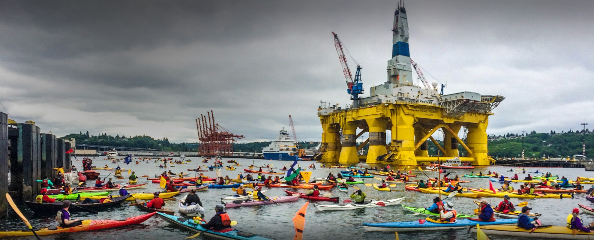 Hundreds of kayaktivists swarm Shell Oil's drilling rig Polar Pioneer, as it arrives in Elliot Bay at the Port of Seattle on May 15, 2015.