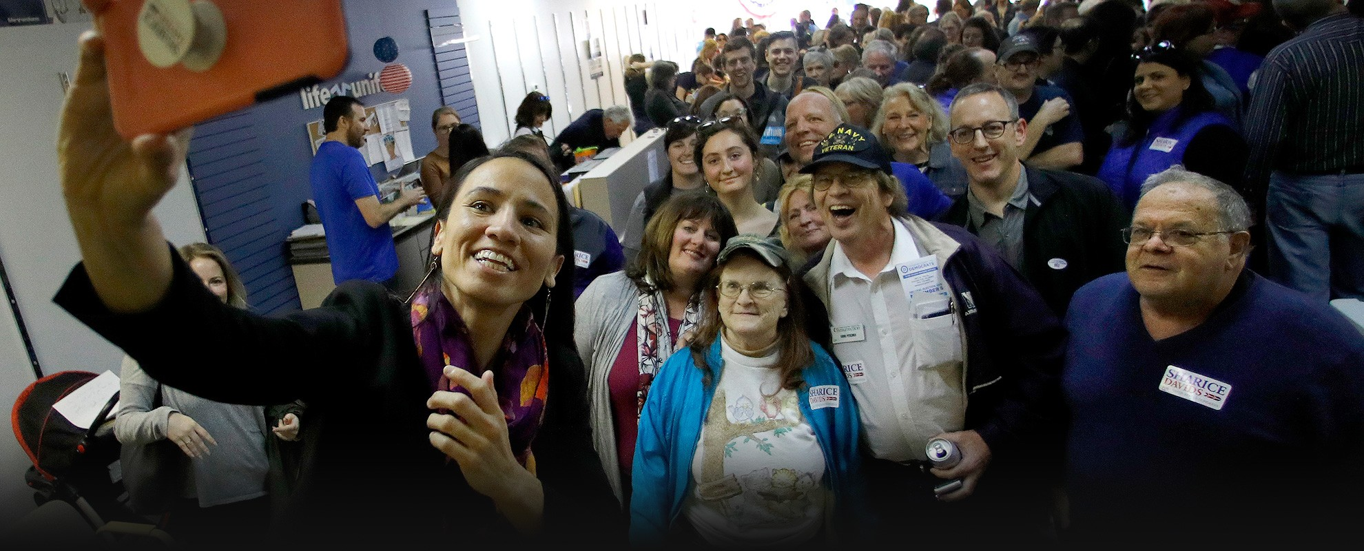 House candidate Sharice Davids takes a photo with supporters during a rally at her campaign office on Nov. 3, 2018, in Overland Park, Kan. Davids challenged Incumbent Republican U.S. Rep. Kevin Yoder for Kansas' 3rd Congressional District seat, and won he