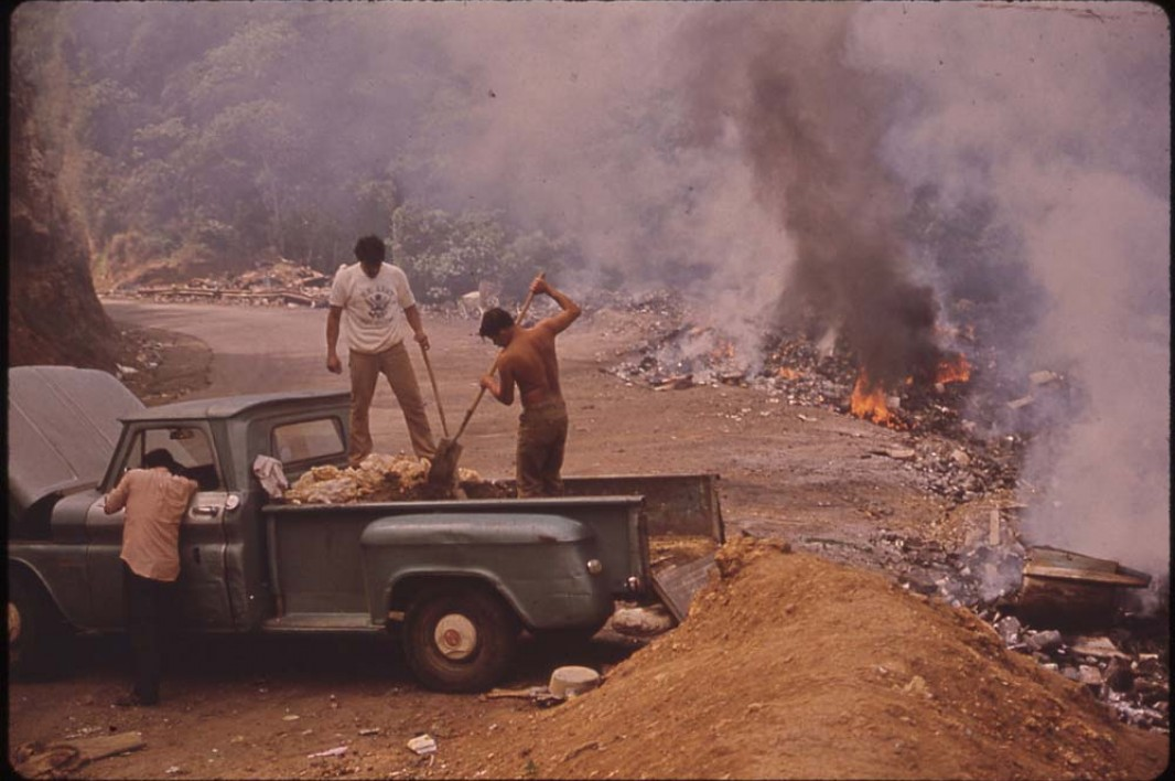 February 1973: Burning garbage at an open dump on highway 112