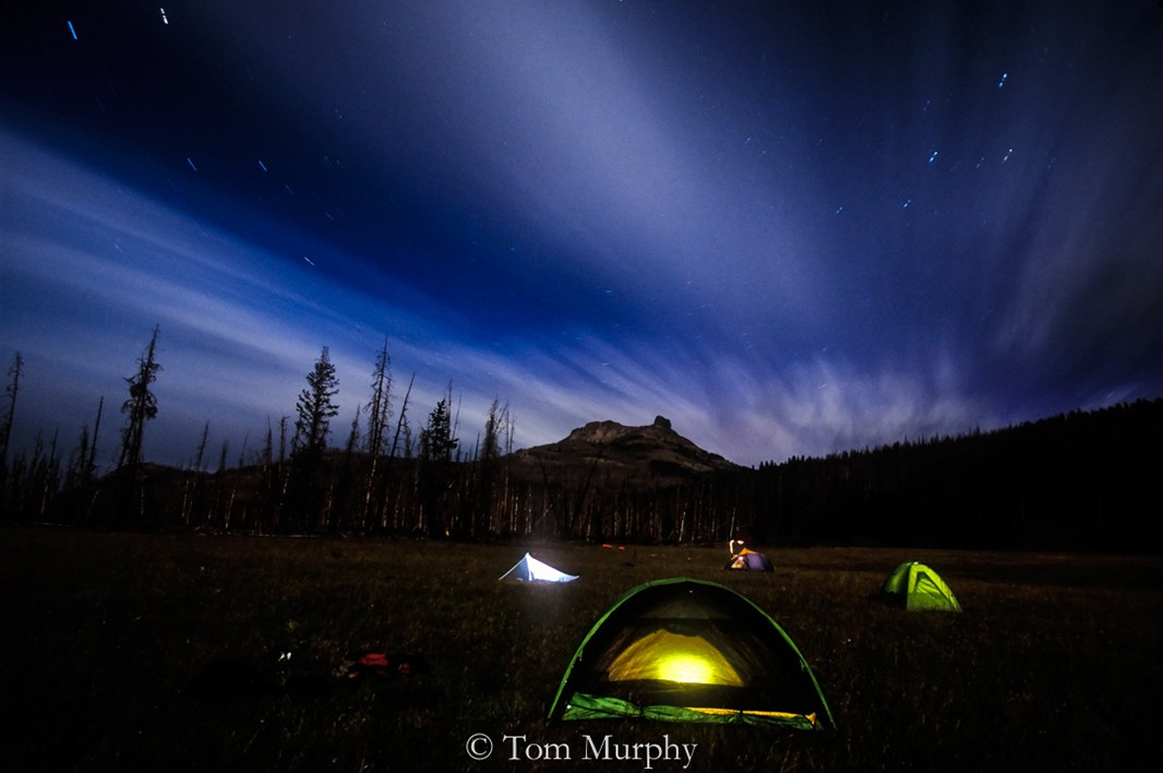 During the ten minute exposure, I walked in front of the camera going from one tent to the next and illuminated each with a small hand-held flash.