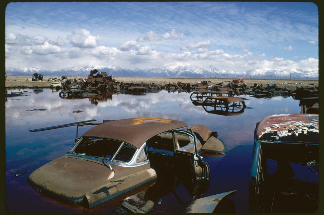 Abandoned automobiles and other debris clutter an acid water- and oil-filled five-acre pond near Ogden, Utah in April 1974. It was cleaned up under EPA supervision to prevent possible contamination of Great Salt Lake and a wildlife refuge nearby.