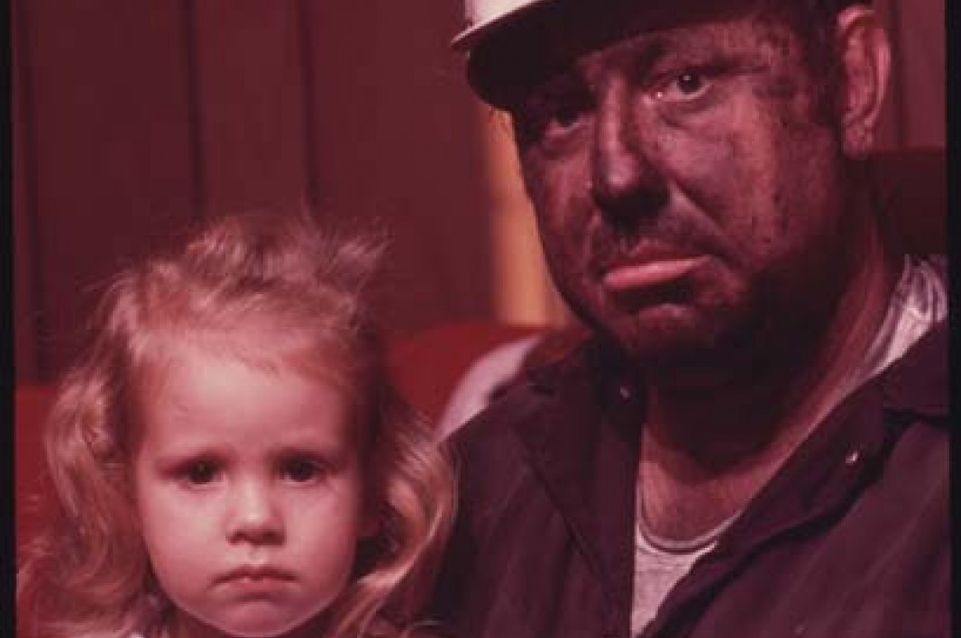 December, 1974: Miner Wayne Gipson, 39, with his daughter Tabitha, 3. He has just gotten home from his job as a conveyor belt operator at a non-union mine.
