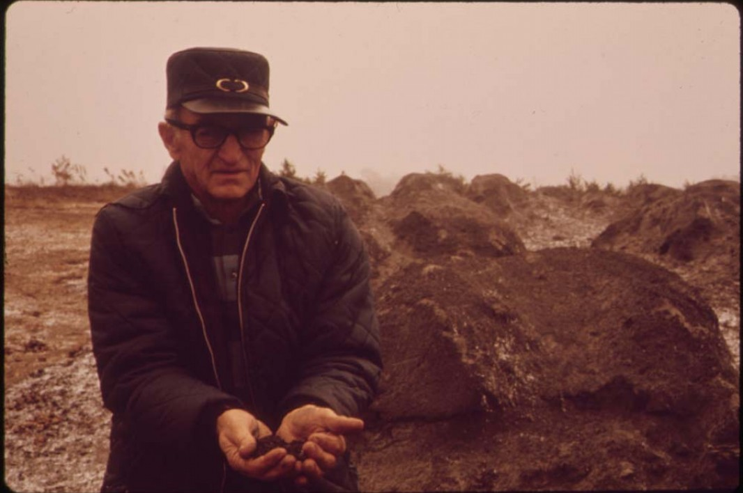 October, 1973: Floyd Lamb holds waste ash that has been shipped from Cleveland and dumped in some of the strip pits off route 33.