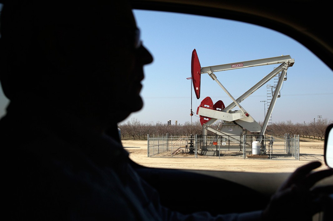 Walt Desatoff drives past an oil rig near his home in Shafter, CA. Desatoff has seen several of the rigs sprout up near his home in the past few years.