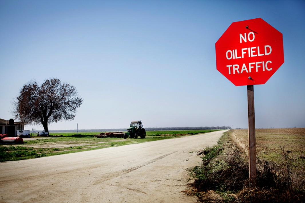 A sign in an agricultural field in Shafter indicates the growing tension between agricultural and oil industries in California's Central Valley, America's most productive cropland.