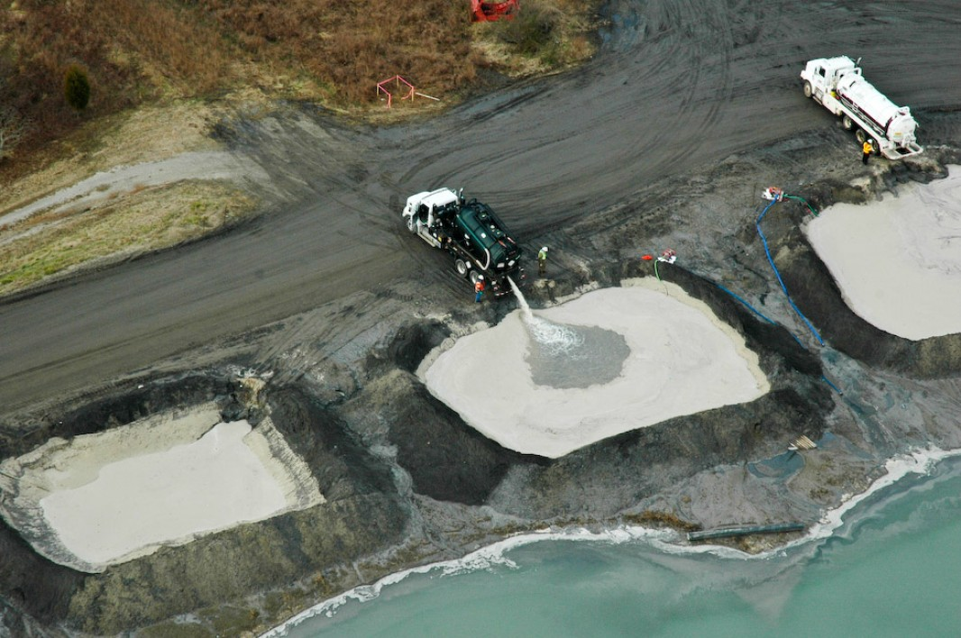 Dumping collected coal ash cenosheres into holding ponds. (Tennessee Valley Authority)