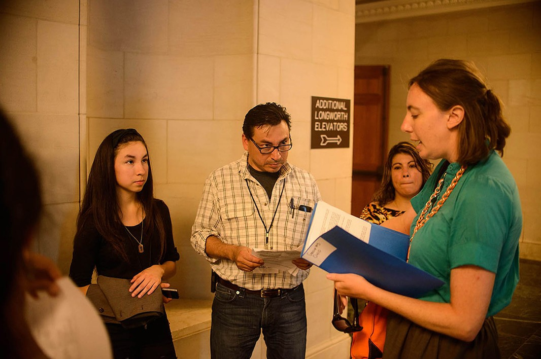 Alexis Guild, Farmworker Justice's Migrant Health Policy Analyst, with Ohio constituents Mario Vargas, a farmworker organizer, his daughter Myra Vargas and Leticia Vargas at the Longworth House Office Building, before one of their meetings on Capitol Hill