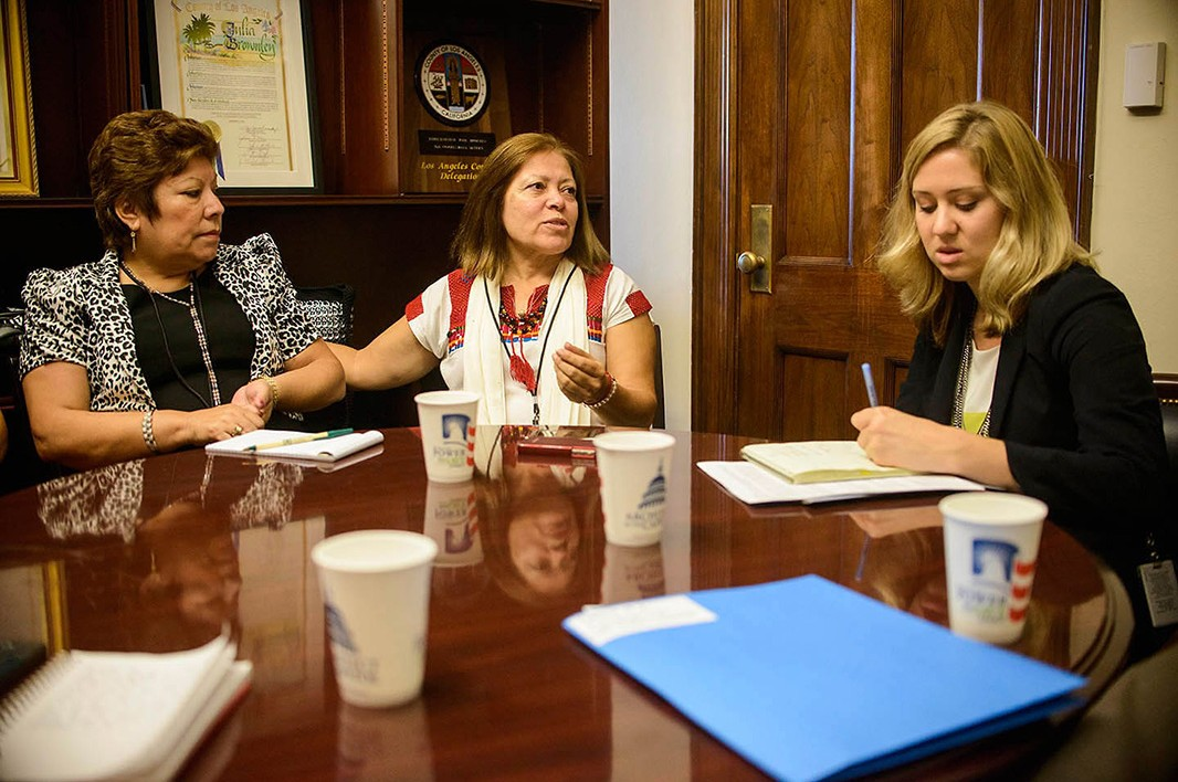 Meanwhile, California constituents Paula Placencia (left) and Mily Treviño-Sauceda (middle) attend a meeting in the office of their congressional representative in the Longworth House Office Building.