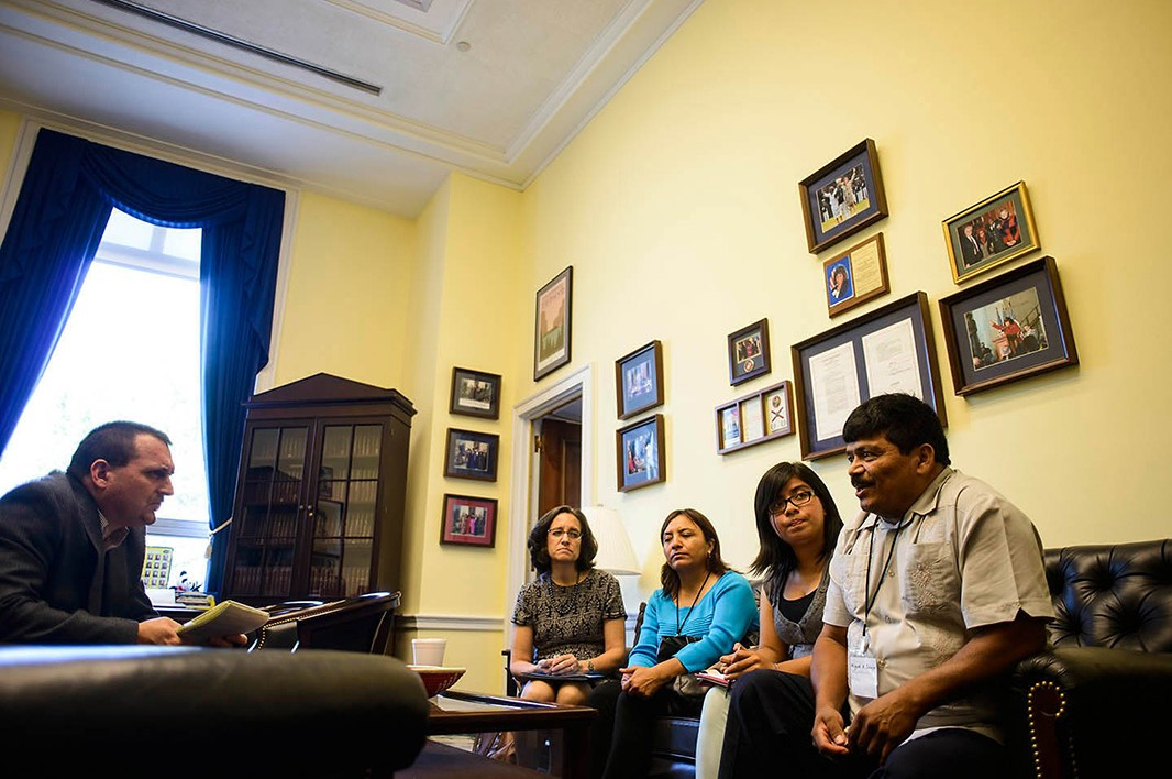 Zelaya, his daughter Selena, and Aguilar, are joined by Virginia Ruiz of Farmworker Justice in a meeting at the Rayburn House Building.