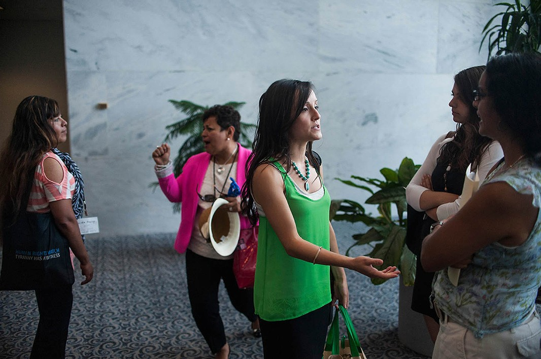 Earthjustice Legislative Representative Andrea Delgado (middle) speaks with colleagues in the Hart Senate Office Building, as Franco and Diaz share a relaxed moment following their meeting with their senator's office.