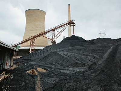 The Big Sandy coal-fired power plant burns through 90 railroad cars of coal daily. The Kentucky Power Company had proposed a near billion dollar upgrade—but the price tag would have been passed along to Kentucky ratepayers. (Shawn Poynter)