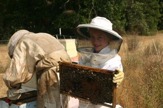Eric McEwen and his daughter Fern Waters McEwen working on the apiary.