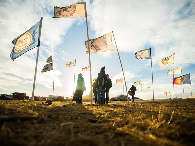 Flags fly at the Oceti Sakowin Camp in 2016, near Cannonball, North Dakota.
