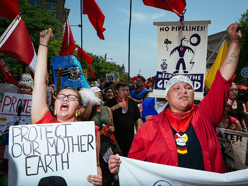 Rose Whipple, left, of St. Paul, Minnesota, who spoke of fighting for our Earth, marches next to her friend Amber Cross of Bemidji, Minnesota.
