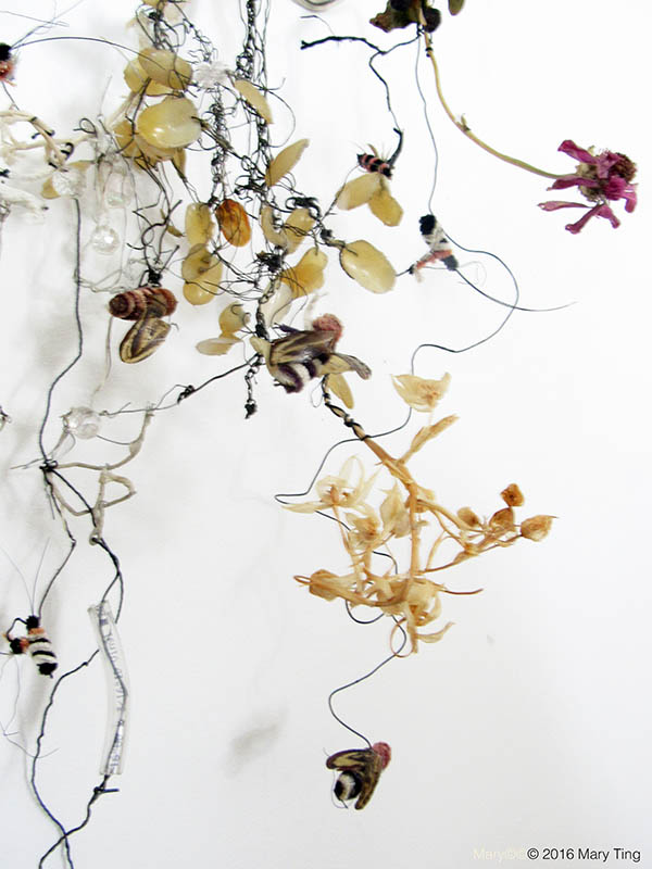 <em>Toxic Fairytale</em> (detail) is a poisonous brew of wire, plastic beads and tubing, fake nails, rubber, dried flowers and confused and ailing pipe cleaner bees.