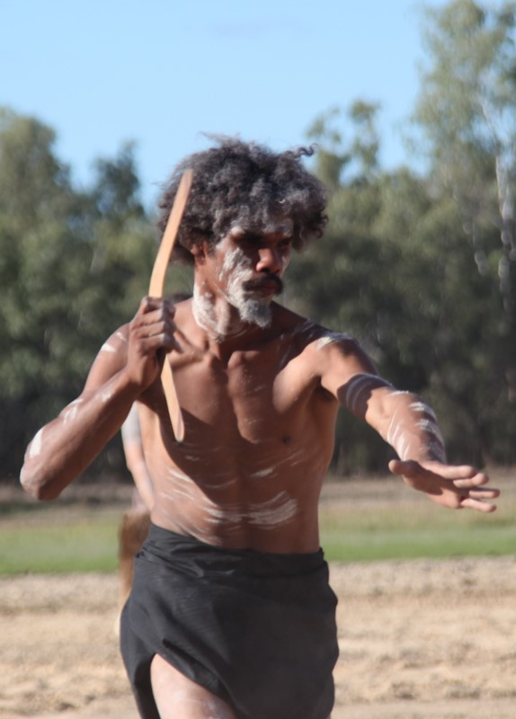 A man participates in a ceremonial dance on Wangan and Jagalingou ancestral lands.