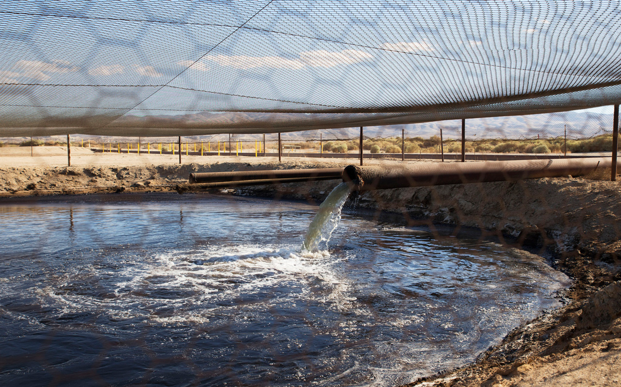 An unlined wastewater pit filled with drilling and fracking water in Kern County, CA.