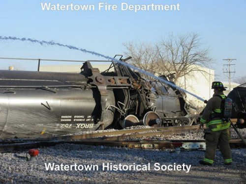 Derailed tank cars, west of Montgomery Street crossing. (Photo courtesy of Watertown Historical Society)