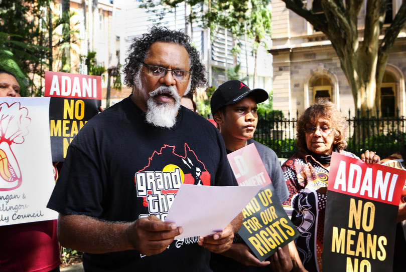 Wangan and Jagalingou community elder Adrian Burragubba speaks at an event to raise awareness about the Carmichael mine's threat to his peoples' traditional land.